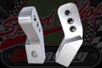 Foot peg risers for solid mounted pegs